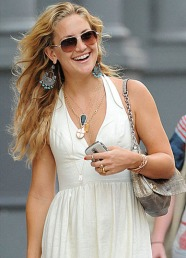 Kate Hudson layers the perfect amount of delicate and statement necklaces.